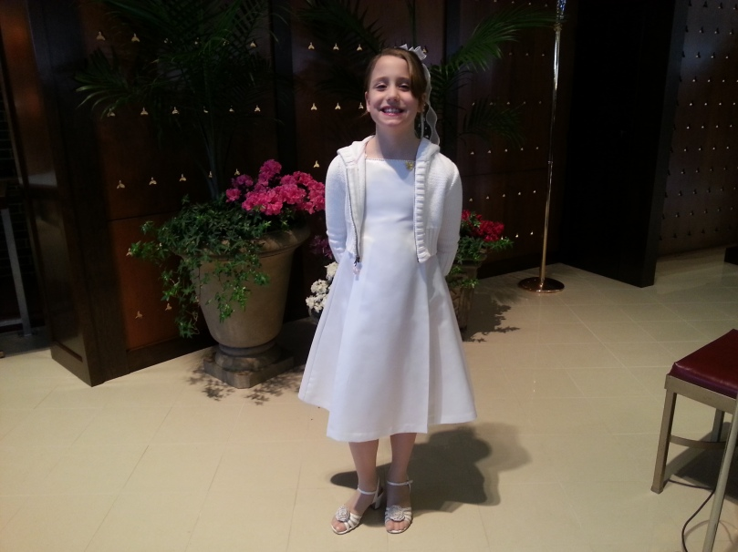Katie on the altar after 1st communion